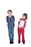 Codo del estornudo de la gripe de la muchacha del muchacho Imagen de archivo libre de regalías