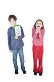 Codo del estornudo de la gripe de la muchacha del muchacho Fotos de archivo libres de regalías