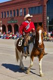 Cody, Wyoming, USA - Cowboy with bright red shirt riding on the Independence Day Parade Royalty Free Stock Photography