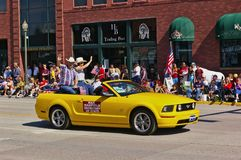 Cody, Wyoming, USA - July 4th, 2009 - Then Wyoming secretary of state Max Maxfield with his wife Gayla Maxfield riding in a conver stock photography