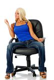 Coed. Relaxes sitting on office chair stock photos
