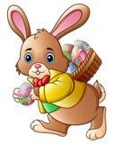 Coelhinho da Páscoa dos desenhos animados que leva uma cesta completamente dos ovos ilustração do vetor