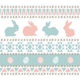 Coelhinhos da Páscoa cor-de-rosa azuis de confecção de malhas do estilo Imagens de Stock Royalty Free