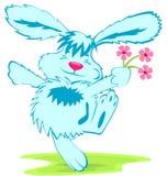 Coelho azul com flores Imagens de Stock Royalty Free