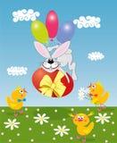 Coelho com um ovo colorido Foto de Stock