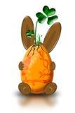 Coelho de Easter com uma planta fotos de stock