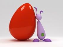 Coelho de Easter perto de um ovo vermelho grande Imagem de Stock