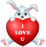 Coelho dos desenhos animados que guarda o coração vermelho Imagem de Stock Royalty Free