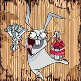 Coelho engraçado dos desenhos animados com presentes em uma parte de cartão Foto de Stock Royalty Free
