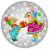 Coelhos bonitos dos desenhos animados com presente de Natal no fundo cinzento Fotografia de Stock Royalty Free
