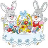 Coelhos com uma cesta da Páscoa ilustração royalty free
