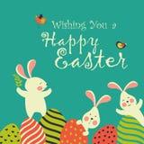 Coelhos e ovos de Easter ilustração do vetor