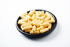 Coenzyme Q10 capsules. Concept for a healthy dietary supplementation. White background. Close up stock photos