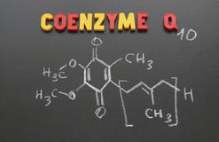 Coenzyme q10. The image and the inscription letters on a blackboard royalty free stock image
