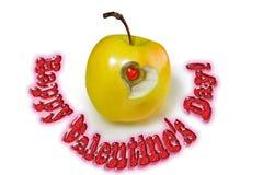 Coeur à l'intérieur d'une pomme douce avec des félicitations Photos libres de droits
