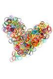 Coeur élastique coloré de forme de bandes élastiques Photographie stock libre de droits