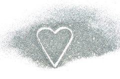 Coeur abstrait de l'étincelle argentée de scintillement sur le fond blanc Images libres de droits