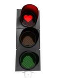 Coeur, amour sur un feu de signalisation Photographie stock libre de droits