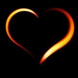 Coeur ardent sur un fond noir Photo libre de droits
