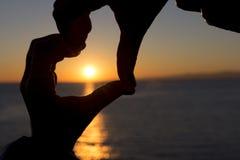 Coeur au coucher du soleil Image stock