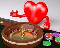 Coeur avec des bras et des jambes derrière la table de roulette dans un casino Photos stock