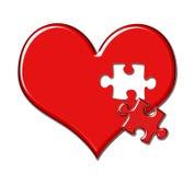 Coeur avec des disparus de partie de puzzle Photos libres de droits