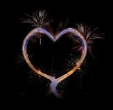 Coeur avec des feux d'artifice Photos libres de droits