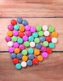 Coeur avec des sucreries Image stock