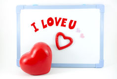 Coeur avec je t'aime le mot sur le conseil blanc Image libre de droits