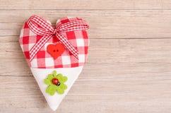 Coeur avec l'arc d'un rippon Photos libres de droits
