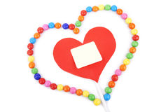 Coeur avec l'espace de copie encadré avec la sucrerie colorée Photos stock