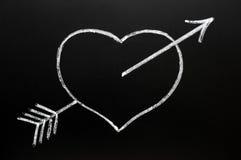 Coeur avec la flèche du cupidon heurtant à travers Photo libre de droits