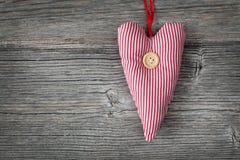 Coeur avec le bouton Images libres de droits