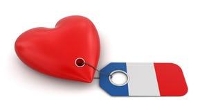Coeur avec le drapeau français (chemin de coupure inclus) Images stock