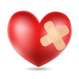 Coeur avec le plâtre Photographie stock