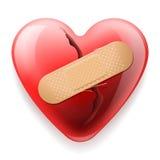 Coeur avec le plâtre sur le fond blanc Photographie stock libre de droits