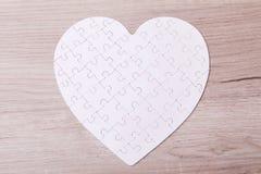 Coeur blanc de puzzle Photos stock