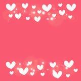 Coeur blanc sur le fond rose Photos libres de droits