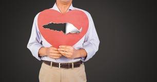 Coeur blessé d'amour de participation d'homme avec le papier déchiré Photo libre de droits