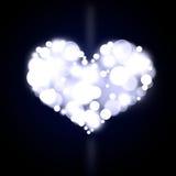 Coeur bleu de bokeh Images libres de droits