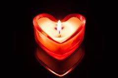 Coeur brûlant de bougie Photographie stock