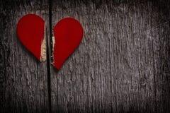 Coeur cassé rouge Photos libres de droits