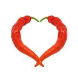 Coeur composé de poivrons de piment rouge Photos stock