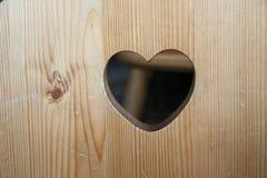 Coeur découpé en bois Images stock