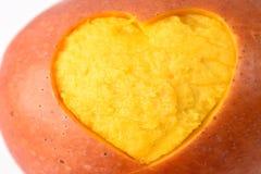 Coeur découpé par mangue Photos stock