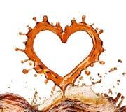 Coeur d'éclaboussure de kola avec des bulles d'isolement sur le blanc Photographie stock libre de droits