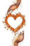 Coeur d'éclaboussure de kola avec des bulles d'isolement sur le blanc Photo stock