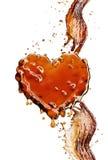 Coeur d'éclaboussure de kola avec des bulles d'isolement sur le blanc Photographie stock