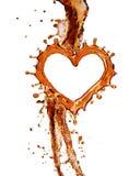 Coeur d'éclaboussure de kola avec des bulles d'isolement sur le blanc Images libres de droits