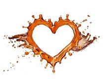 Coeur d'éclaboussure de kola avec des bulles sur le blanc Photos libres de droits